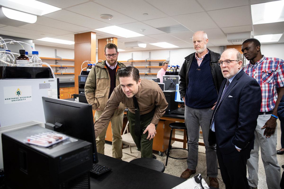 NMU faculty, staff and administrators tour the lab.