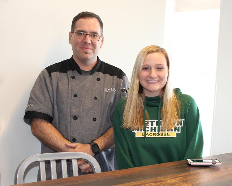 Shane Hawkins of NMU Dining and Tess Kostelec