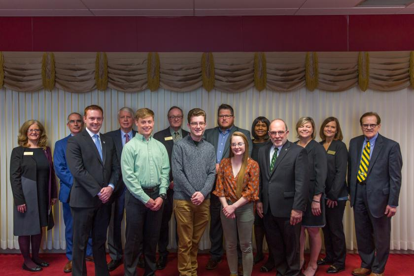 From left: Trustee Tami Seavoy, NMU Board Chair Robert Mahaney, Connor Loftus, Trustee James Haveman, Ryan Watling, Trustee Stephen Young, Michael Stamm, Kevin Store, Hailey Donohue, Trustee Bridget Summers, NMU President Fritz Erickson and Trustees Alexis Hart, Lisa Fittante and Steve Mitchell.