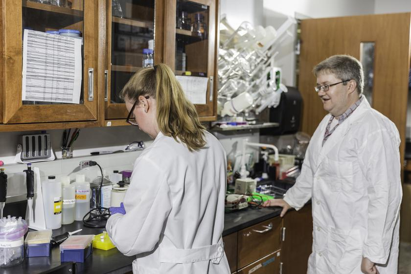 Sharp (right) in his lab with former NMU Lundin Honors Summer Research Fellow Maggie Bohm.