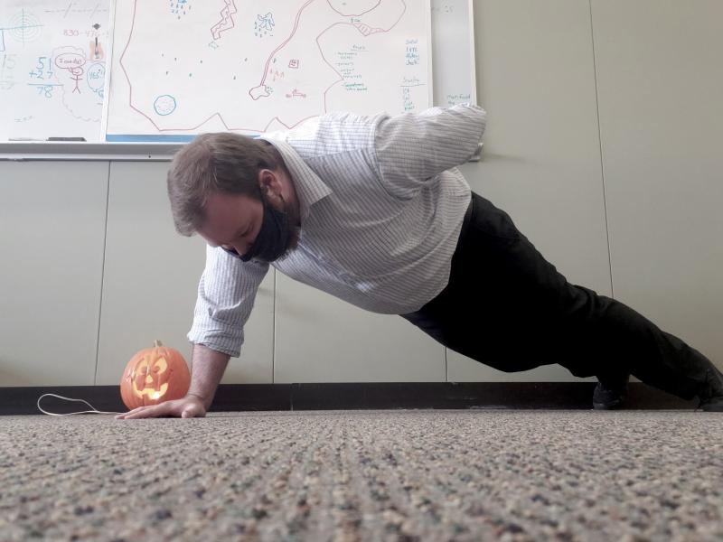 UAW Local 2178 member and challenge participant Ben Chaney does a pushup in his office.
