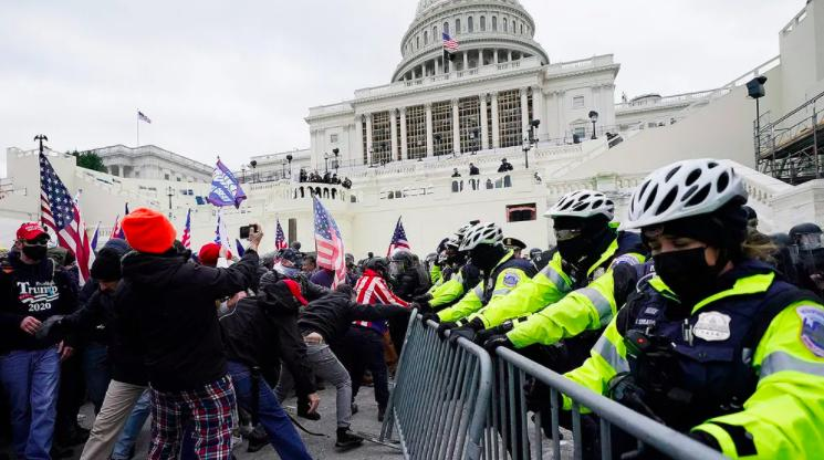 Protesters try to break through a police barrier