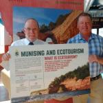Image of President Fritz Erickson delivering ecotourism display piece to NMU alumnus John Madigan