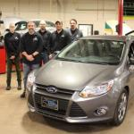 NMU students and faculty with the Ford Focus