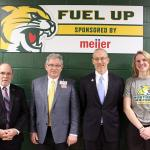 NMU President Fritz Erickson, Marquette Meijer Director John Spaulding, NMU Athletics Director Forrest Karr and Wildcat volleyball player Sarah Kuehn