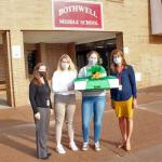 NMU students Sydney Wickstrom and Mackenzie Meyer (second and third from left) make a delivery to Bothwell personnel.